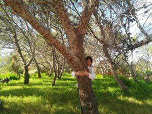 marilda hugging a tree