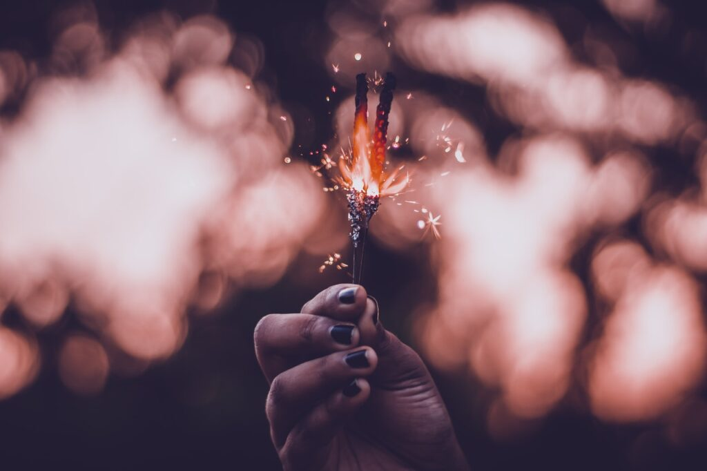 woman-holds-lighted-sparkler-3135232_Photo by Rahul Pandit