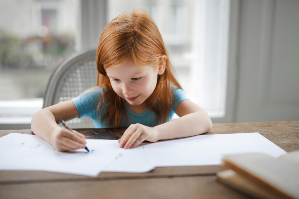 diligent-small-girl-drawing-on-paper-in-light-living-room-at-3755511_Photo by Andrea Piacquadio from Pexels