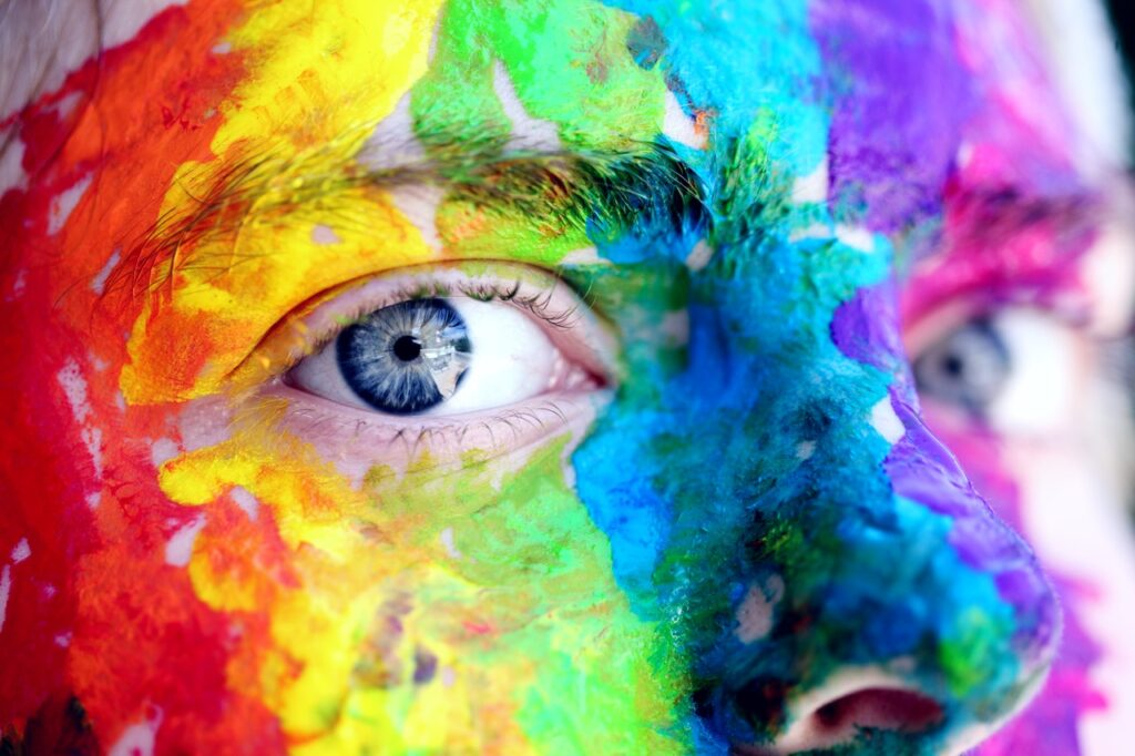 face painted in a rainbow. Photo by Sharon McCutcheon